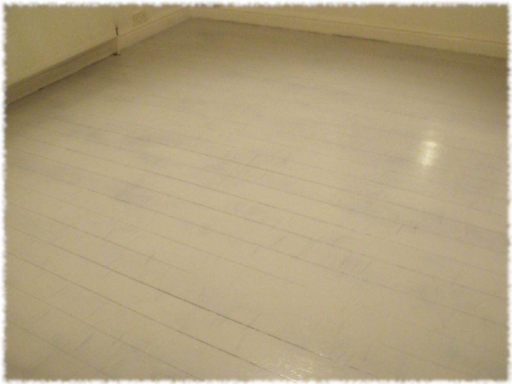 First coat of Nimbus Grey sorted on the front room floor