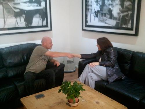 Adrian Shakes Simone's hand.